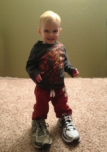 Jude, wearing daddy's shoes